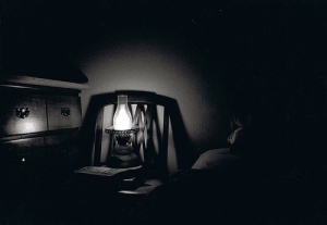 dark bedroom with lantern