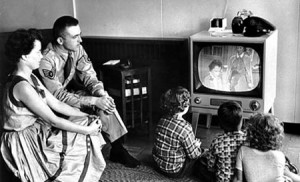 military family watching tv