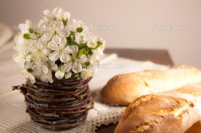Rustic setting with spring flowers and homemade bread